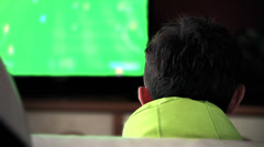Teen playing with game at home (back view) Stock Footage