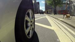 Driving around the city from low angle pov Stock Footage