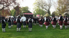 Timelapse bagpipe bands leaving the ceremony place at Highland Gathering Stock Footage