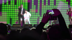 Singer on stage in front of a crowd of spectators at music concert Stock Footage