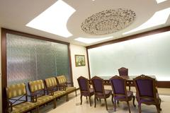 A large mahogany conference room table with leather chars Stock Photos