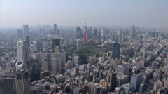 Aerial Tokyo Tower Dentsu  skyscraper Minato Business district Japan - stock footage