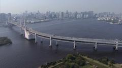 Aerial Rainbow Bridge vehicle Tokyo City Shuto Expressway Japan Stock Footage