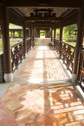 Traditional Chinese architecture, long corridor in outdoor park - stock photo