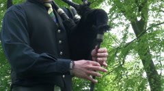 Bagpipe player hands on bagpipe close up Stock Footage