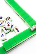 Mahjong tiles aligned and two dices - stock photo