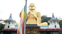 Tracking shot of the entrance of the Golden Temple of Dambulla. Stock Footage
