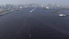 Aerial nautical vessels Rainbow Bridge Odaiba Tokyo Shuto Expressway Stock Footage