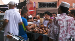 Morocco, Marrakech. People buying bread from a vendor during Ramadan - stock footage