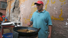 THE MAIN BAZAAR, MARRAKECH - AUGUST 1, 2013: Man fried fish at market on August Stock Footage
