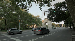Cars pass by the Sailor's Arch in Grand Army Plaza Stock Footage
