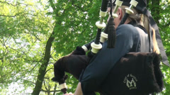 Female bagpipe player close up at Highland Gathering Stock Footage