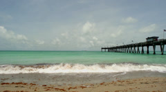 Sandy Beach with Pier - stock footage