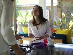 Young pretty woman with her boyfriend help preparing  breakfast at home. NTSC Stock Footage