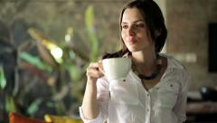 Young woman finishing work on laptop, drinking tea and relaxing at home HD Stock Footage