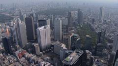 Aerial Tokyo Metropolitan Government Building Shinjuku Gyoen National Garden - stock footage