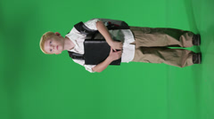 A young boy ready for school green screen shot Stock Footage