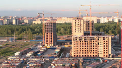 Camera review of new residential district under construction, to the right Stock Footage