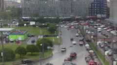 Blurred view of city street with cars through the glass with rain drops Stock Footage