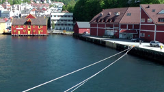 North Europe Norway City of Bergen 057 the ropes loosen to undock cruise ship Stock Footage