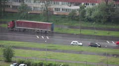 Strong rain on city streets and riding car on slippery road Stock Footage