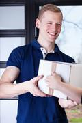 man receiving a package - stock photo