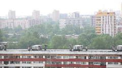 View over building roofs during strong rain in the city, Russia Stock Footage