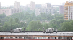 Rain falling down over city roofs, Russia Stock Footage