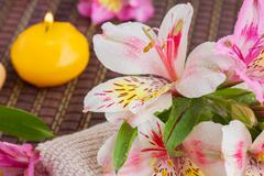 spa setting with alstroemeria flowers - stock photo