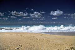 Blue sea with waves and sky with clouds Stock Photos
