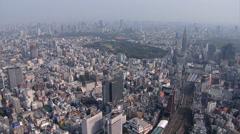 Aerial Tokyo Shinjuku Gyoen Park National Garden Hanami Shinjuku Rail Station Stock Footage
