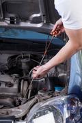 Mechanic checks the engine oil quantity Stock Photos