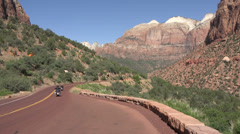 Zion National Park motorcycles down canyon road HD Stock Footage