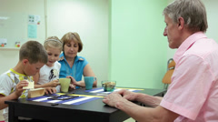 Granddad playing the domino agaist grandmother with grandchildren - stock footage
