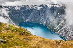 Beautiful norwegian landscape with mountains on the the way to trolltunga Stock Photos