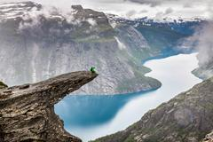 norway mountain trolltunga odda fjord norge hiking trail - stock photo