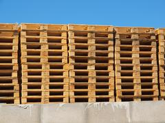 Stock of new wooden euro pallets at transportation company Stock Photos