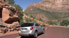 Zion National Park traffic down mountain road HD Stock Footage