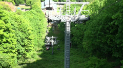 Open seat cable car drive near valley station in Thale Stock Footage