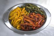 Stock Photo of sweet multicolor roast pepper strips on plate