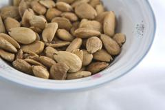 Stock Photo of fried almonds on a bowl, detail