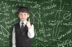 Boy near blackboard with formulas Stock Photos