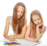 sisters draw on the album - stock photo