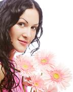 Attractive young woman face with flowers Stock Photos