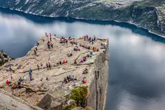 Norway - june 2, 2012: unidentified group of tourists enjoy breathtaking view Stock Photos