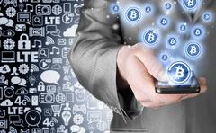 Hand with mobile smart phone and bitcoin symbol - stock illustration
