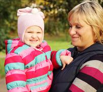 Mum with a daughter in autumn park Stock Photos