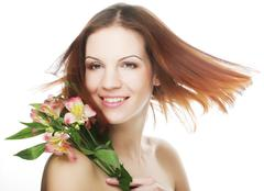 Stock Photo of beautiful woman with pink flower