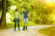 Lovers in nature on rollerblades Stock Photos