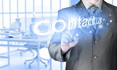 Businessman pushing CONTACT US sign Stock Illustration